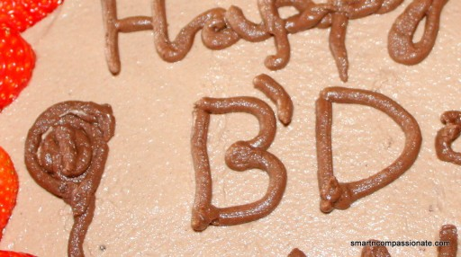 Add extra cacao powder to a portion of the frosting to write on the cake.