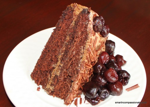 Topped with dark chocolate shavings and cherries.